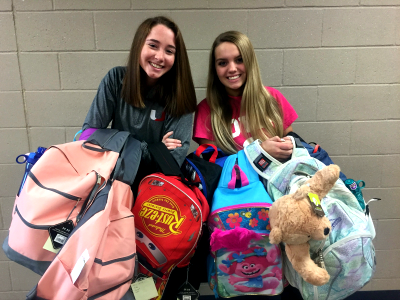 Claire Kaiser and Bailey Lamm creating backpacks for children entering foster homes as part of Hope In Action_site